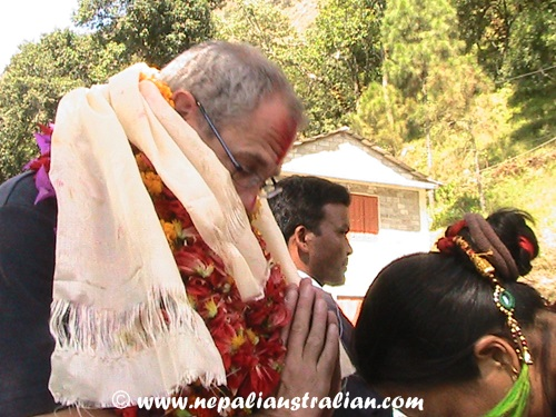 Mike Crawshaw in Nepal with garlands